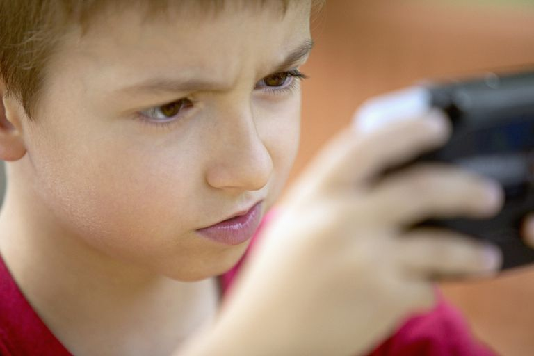 Boy playing portable video game