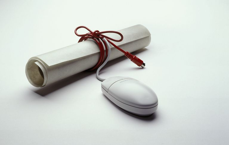 Computer mouse w/ cord wrapped around diploma