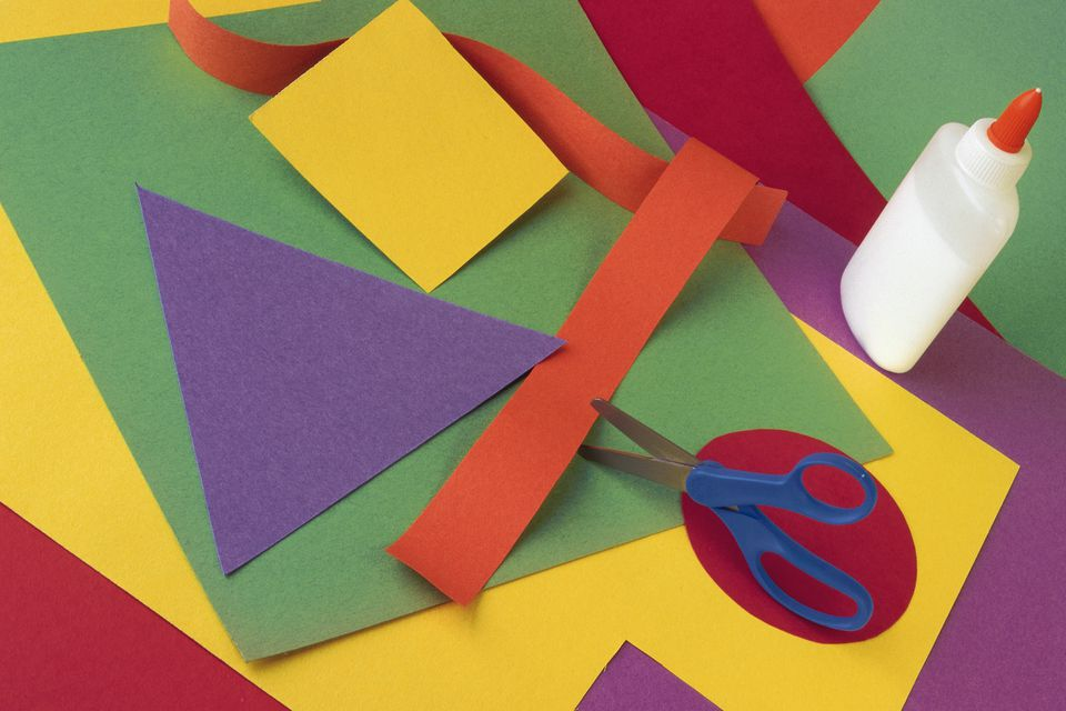Construction paper cutouts of shapes with scissors and glue