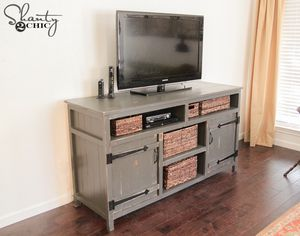 A Distressed Gray TV Stand In Farmhouse Style