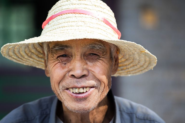 Portrait of old farmer smiling, China