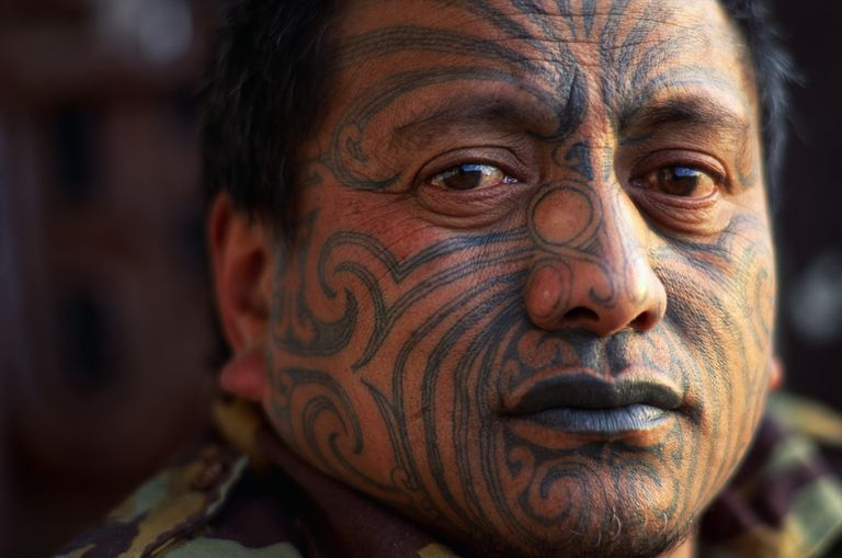 Indigenous man with tattooed face