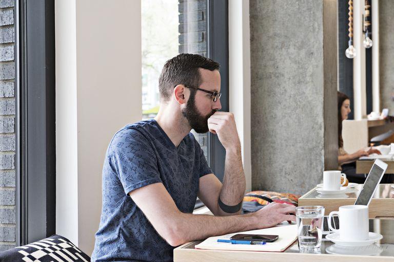 Man on laptop at cafe