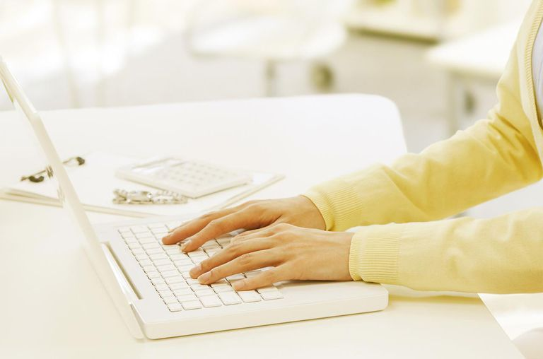Woman Hand On Keyboard