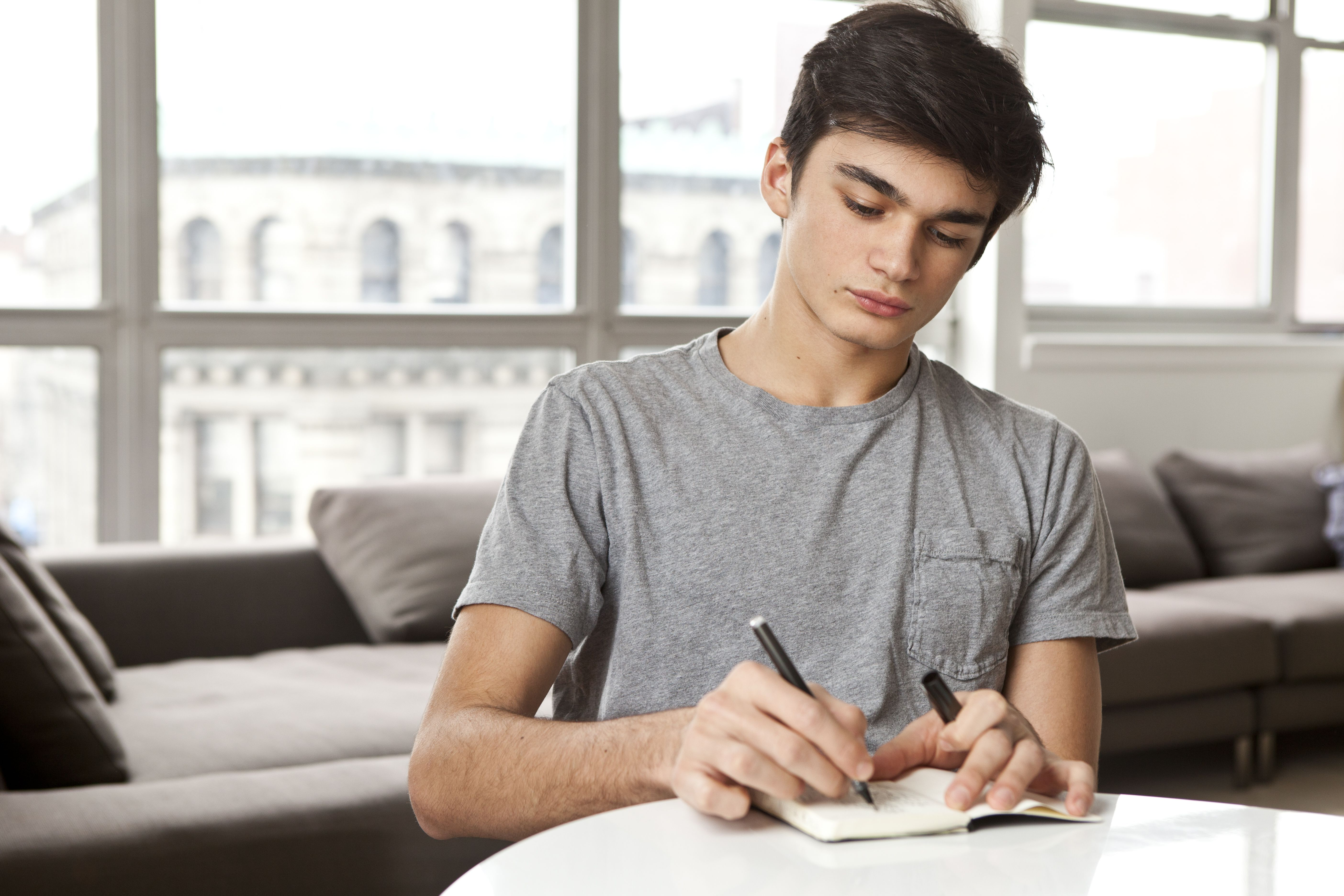 tips for writing a successful college transfer essay teenager at home writing notes