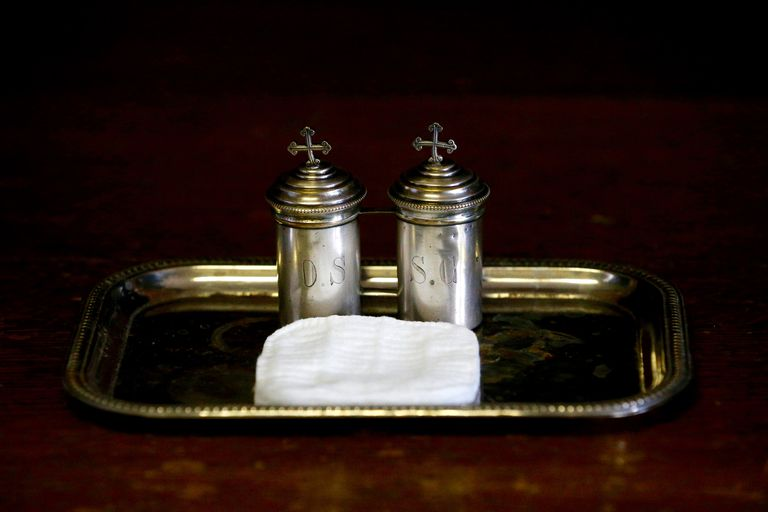 Containers of chrism