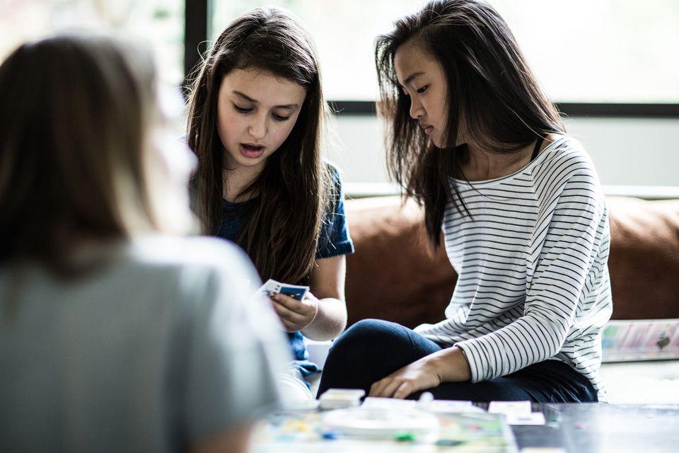 Girls playing board game