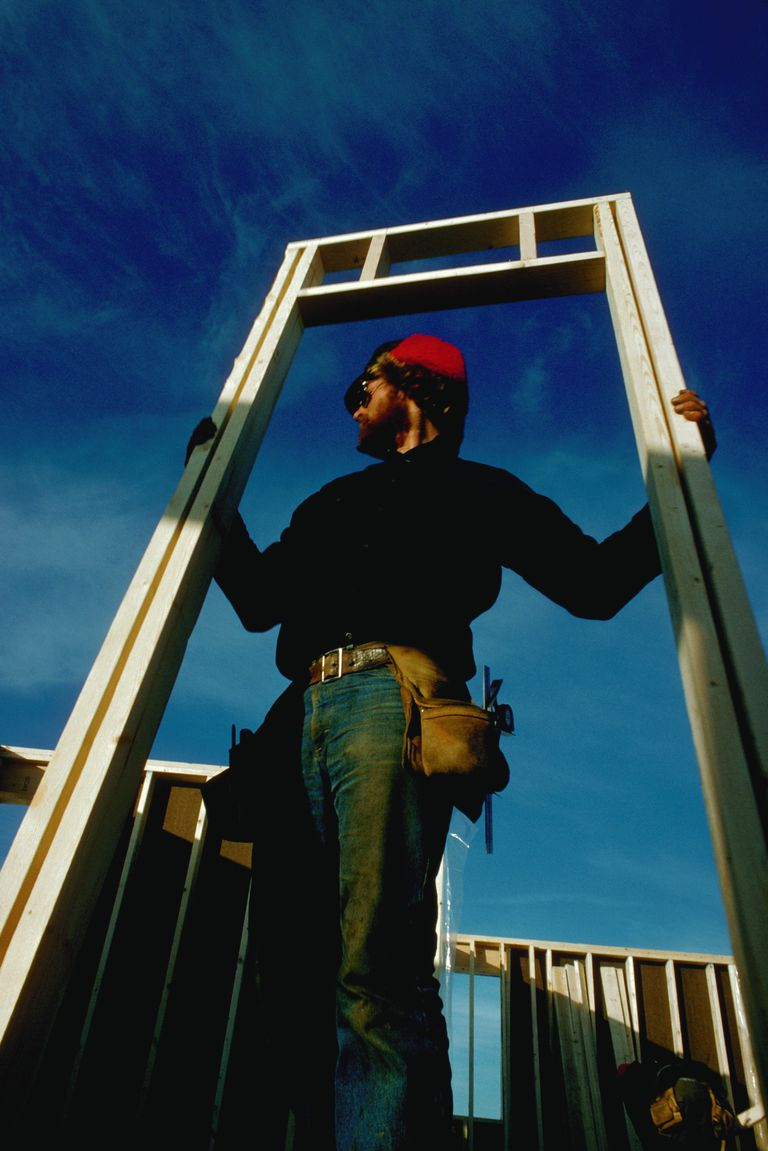 Builder Carrying Door Frame