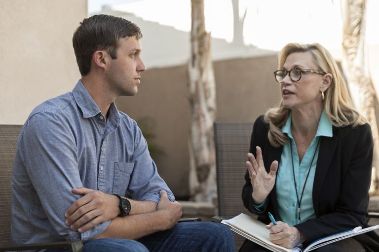 man talking to therapist in therapy