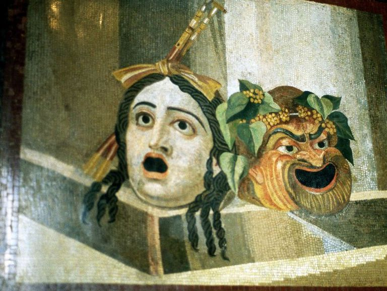 Theatrical masks of comedy and tragedy on Roman mosaic.