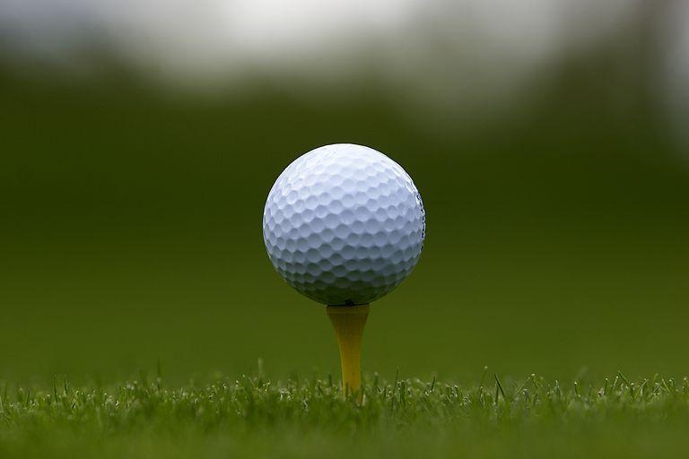 Close-up of a golf ball on a tee