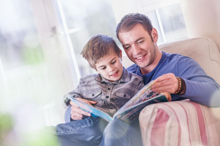 Dad and Son Reading Together