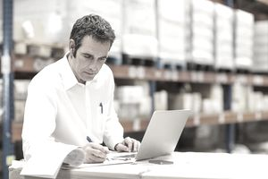 customs broker working on laptop