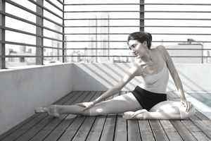 Ballerina exercising/stretching on sun deck
