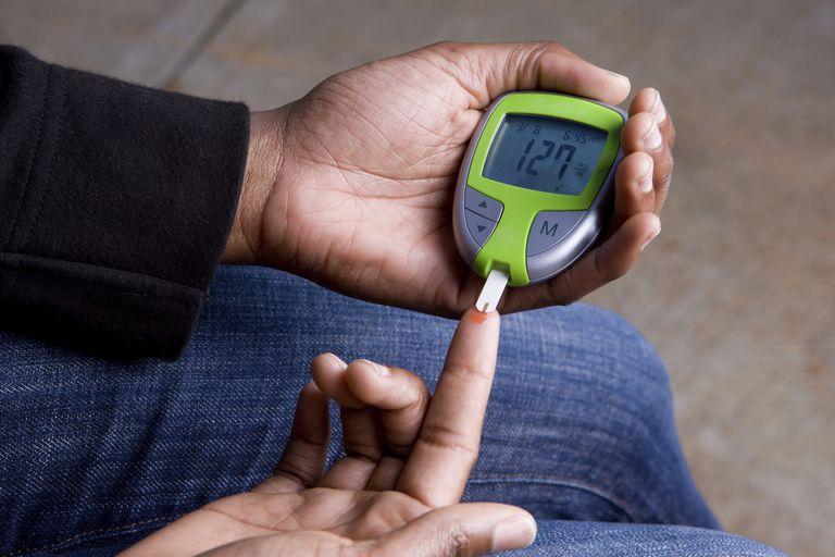 A diabetic testing her blood sugar.