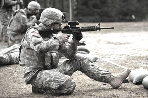 Soldier firing M4 rifle