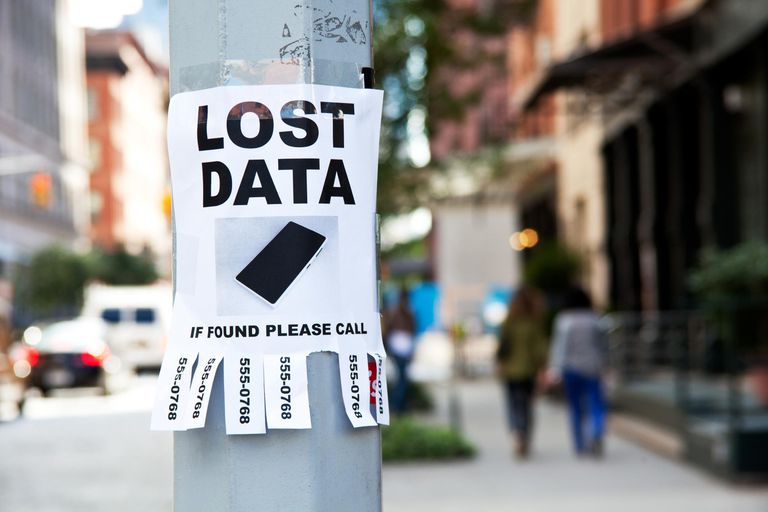 'Lost Data' sign taped to light post in city