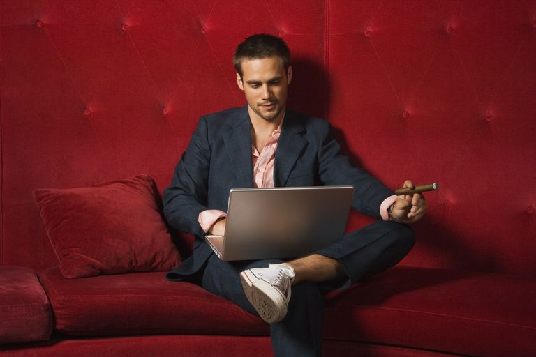 Man with cigar using a laptop