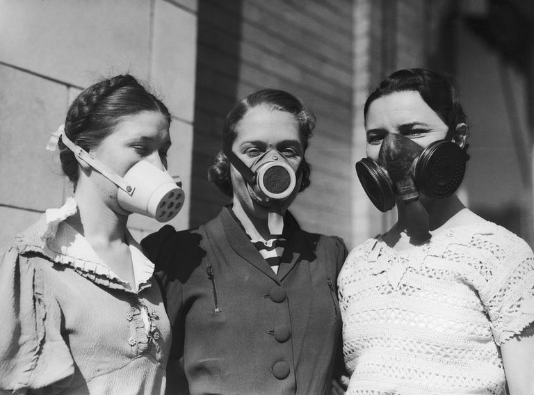 Picture of three girls wearing Dust Bowl masks.
