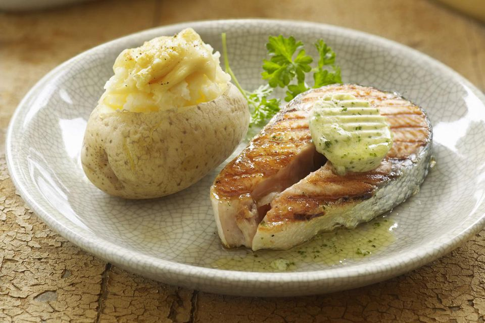 Salmon with herb butter and baked potato