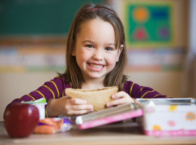 Kid eating a packed lunch