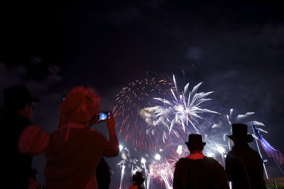 War of 1812 reenactors watch a fireworks display following a ceremony to commemorate the bicentennial of the writing of The Star-Spangled Banner at Fort McHenry National Historic Park on September 13, 2014 in Baltimore, Maryland. The poem verses were written by Francis Scott Key in the War of 1812, during a British naval bombardment of Fort McHenry from the Chesapeake Bay, and adopted as The National Anthem 200 years ago.