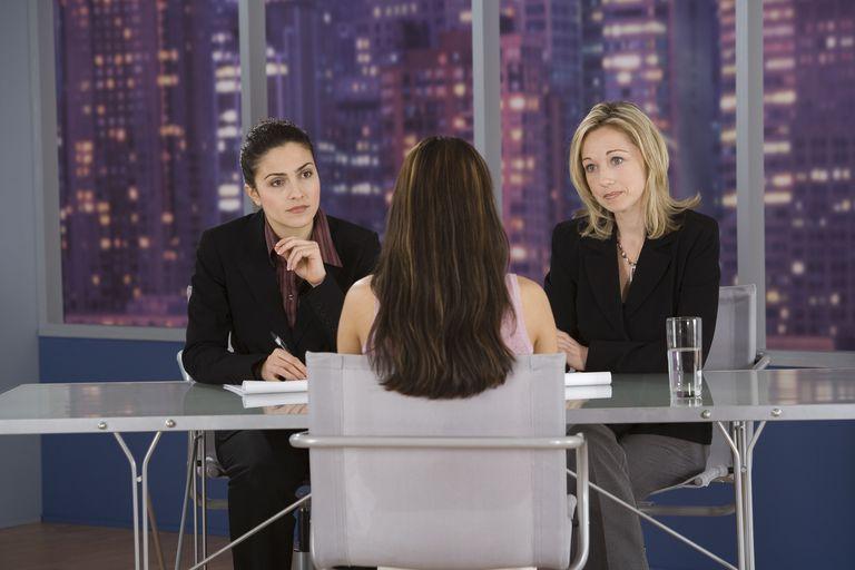 Businesswomen interviewing woman