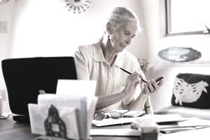 Elderly woman in office