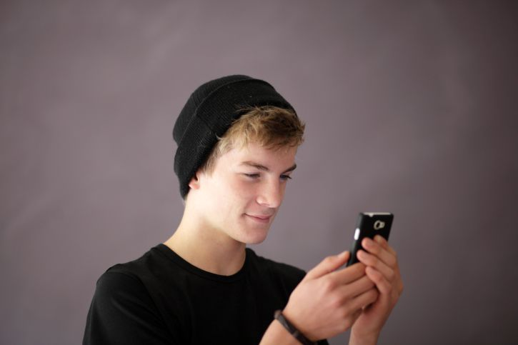 Teen Boy Using Smartphone