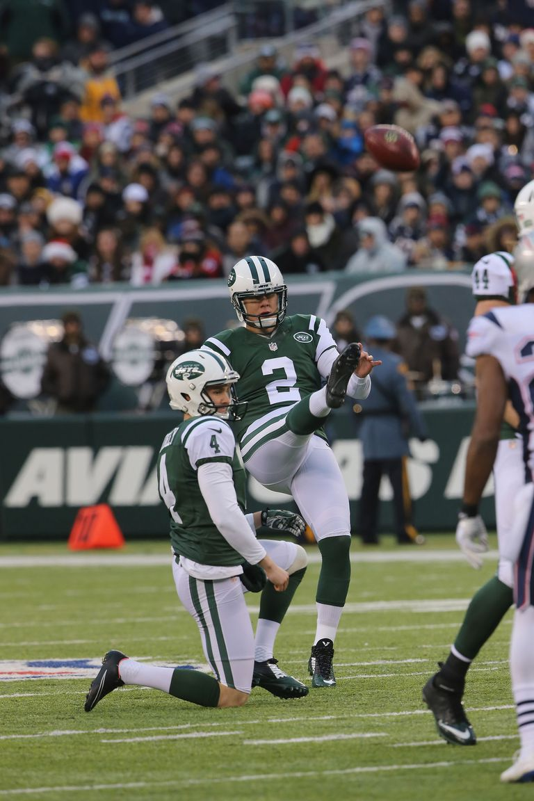 Kicker Nick Folk #2 of the New York Jets has a 'Pooch Punt' against the New England Patriots at MetLife Stadium on December 21, 2014
