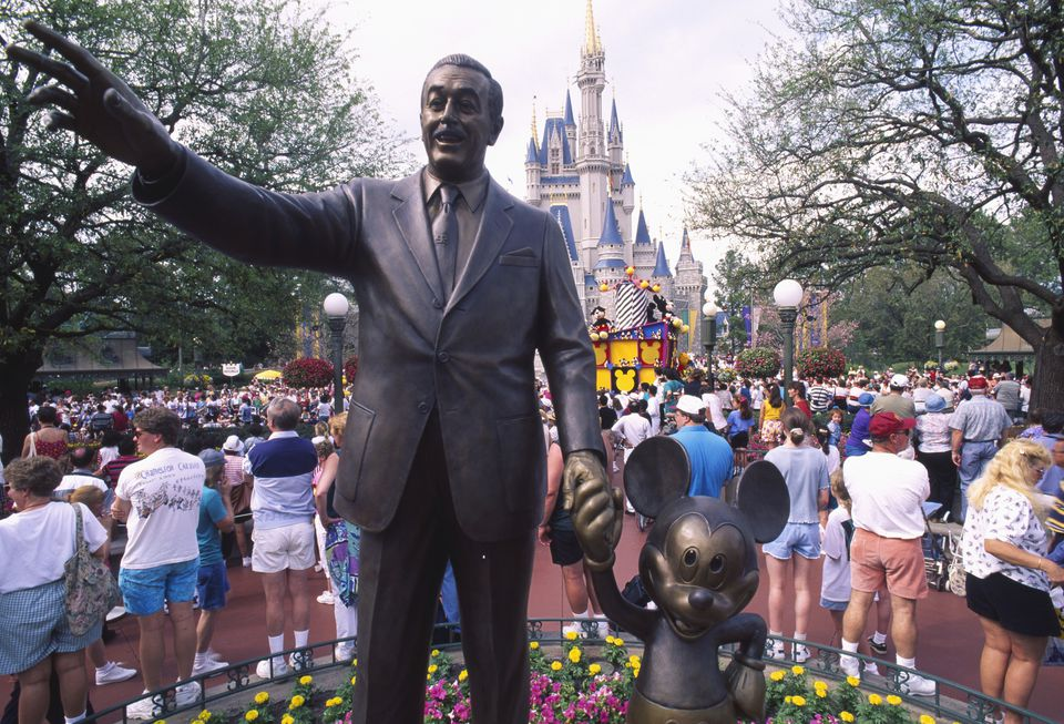 A statue of Walt Disney and Mickey Mouse at Disneyworld.