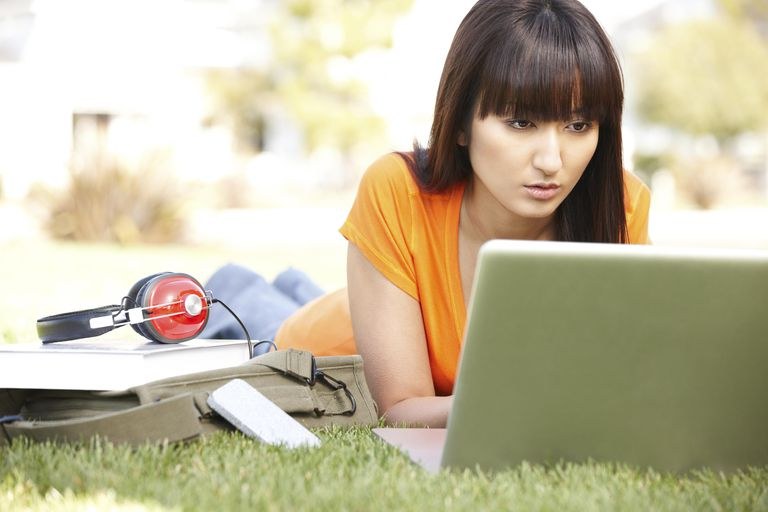 Japanese college student studying on compu...