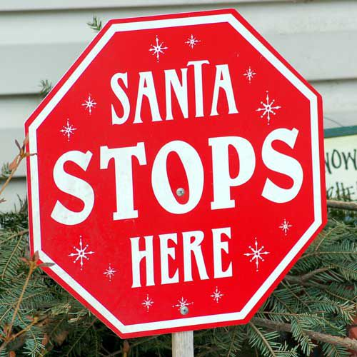 Stop signs halt our progress, but this 'Santa Stops Here' stop sign gives Santa the green light.