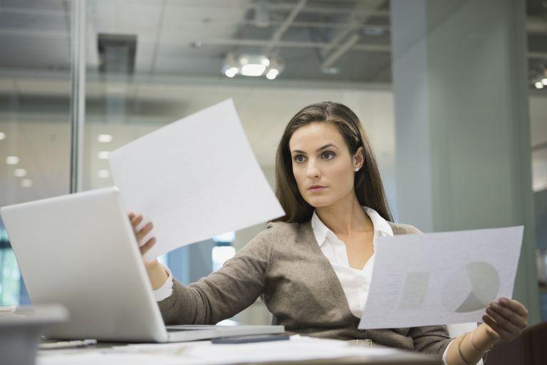 Woman evaluating company stock distribution options.