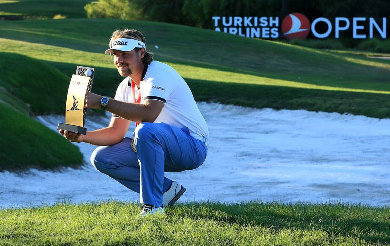 Victor Dubuisson of France poses with the trophy after victory in the 2015 Turkish Airlines Open