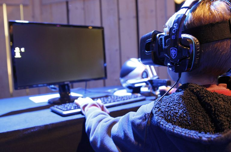 A gamer plays a game with the virtual reality head-mounted display