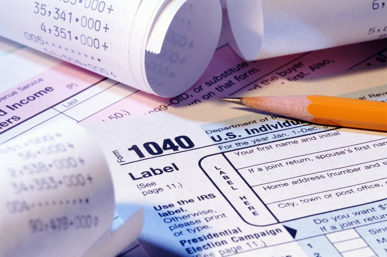 Tax forms, pencil and receipts, close-up