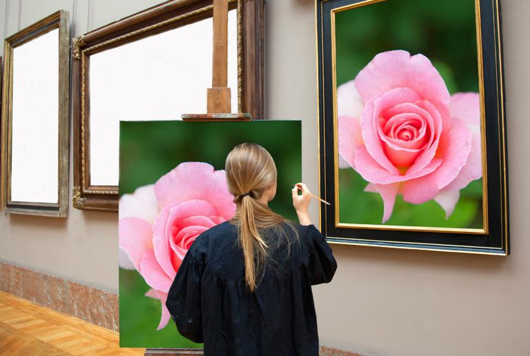 Woman painting a rose