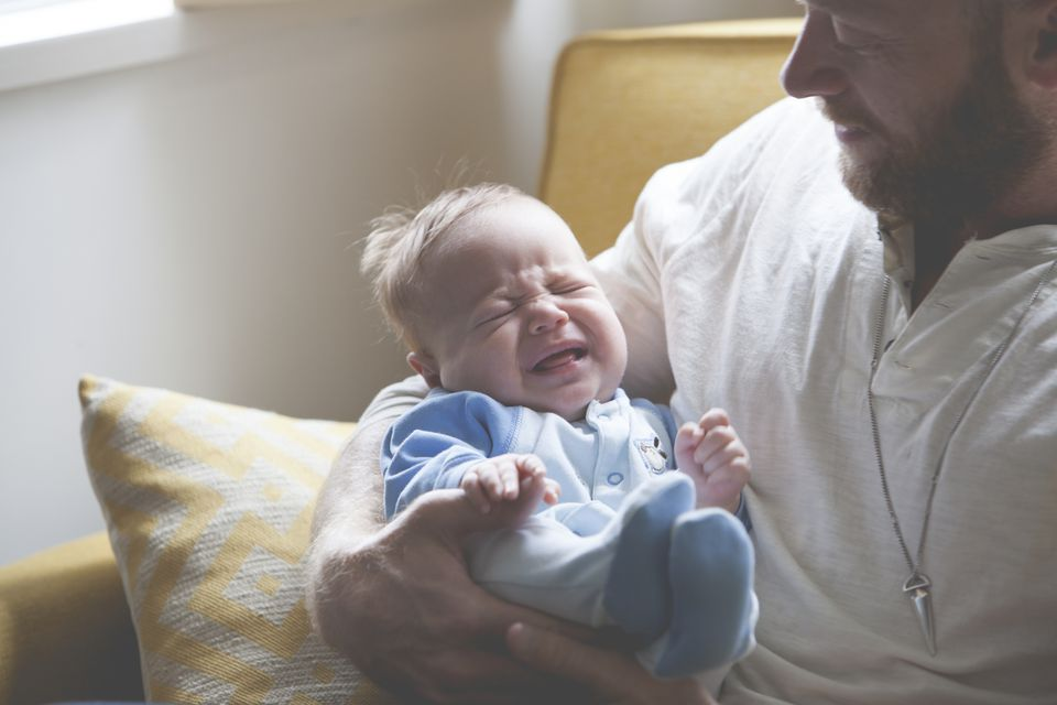 Father with a Crying Baby
