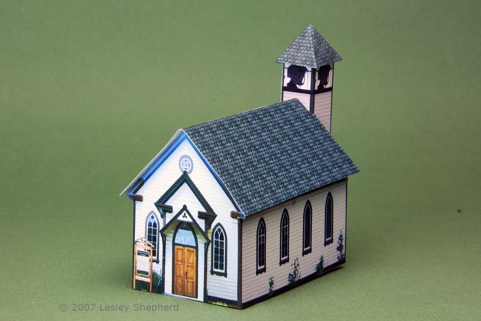 A paper miniature village church with a bell tower in 1:144 scale
