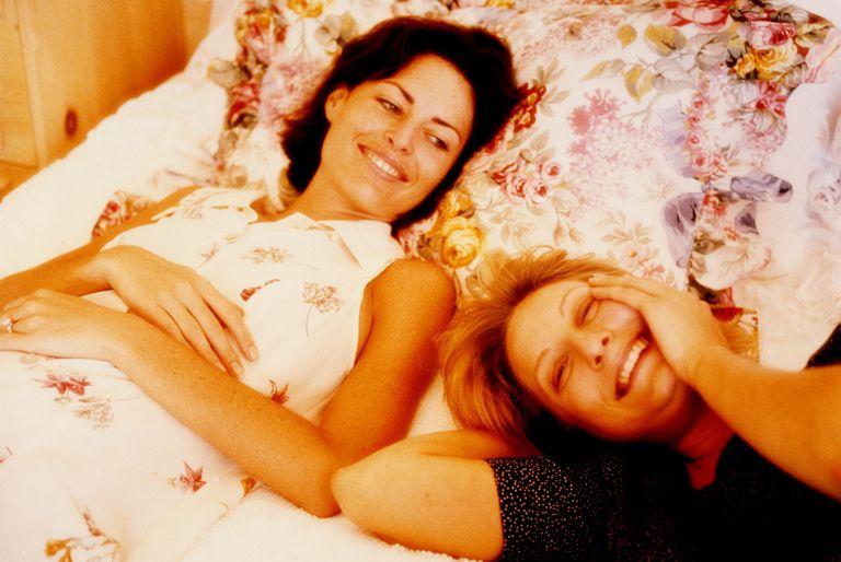 Two women relaxing on bed, portrait