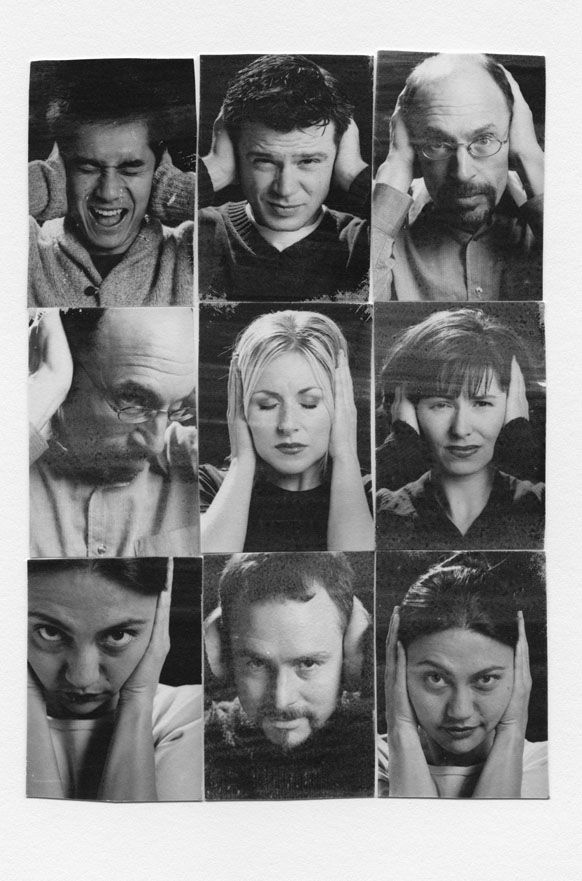 Various people covering their ears