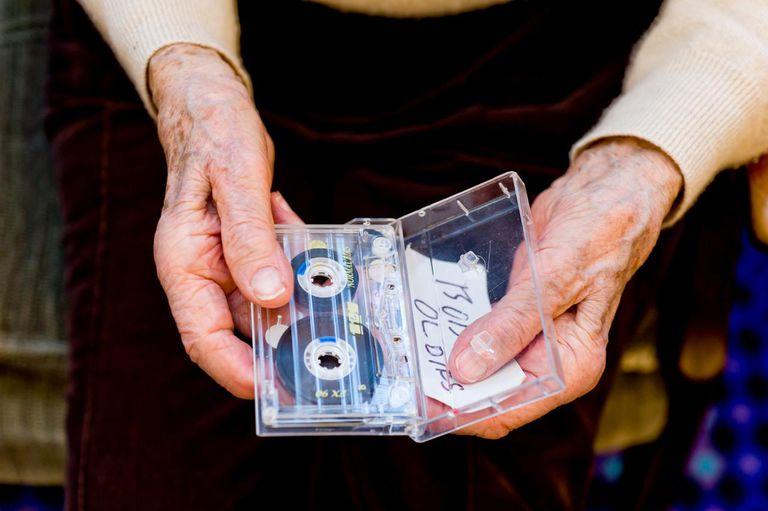 enior woman holding cassette tape
