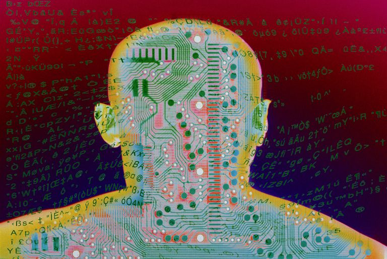 Outline of bald man's head with circuit board and HTML text