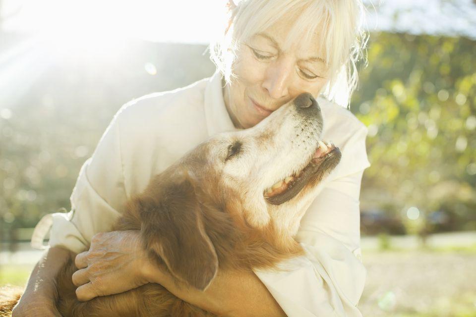 Woman loving dog