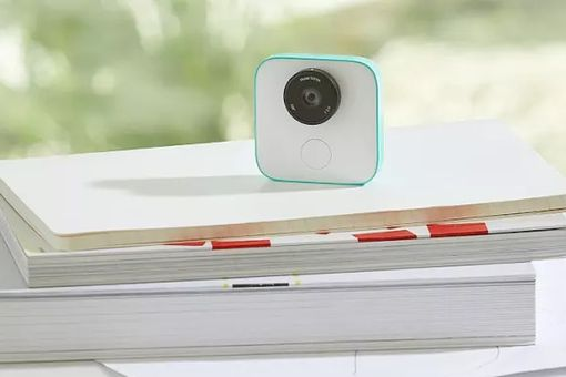 The Google Clips camera sitting on top of a stack of textbooks
