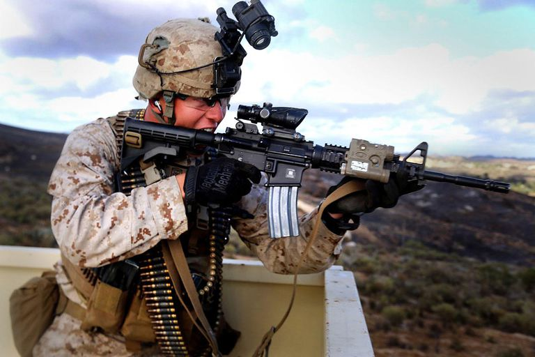 A Marine with Echo Company, Battalion Landing Team 2nd Battalion, 1st Marines, 11th Marine Expeditionary Unit, simulates engaging a potential threat as part of a mechanized raid training event during Composite Training Unit Exercise (COMPTUEX), May 20. COMPTUEX is the second at-sea period during the 11th MEU's predeployment cycle, during which the MEU will conduct concurrent mission planning and execution integrated across all elements of the Marine Air Ground Task Force while supporting Amphibious Squadron 5 in their evaluated training.
