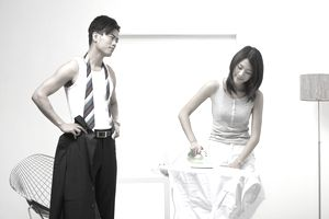 Impatient Man Waiting for Woman to Iron Shirt