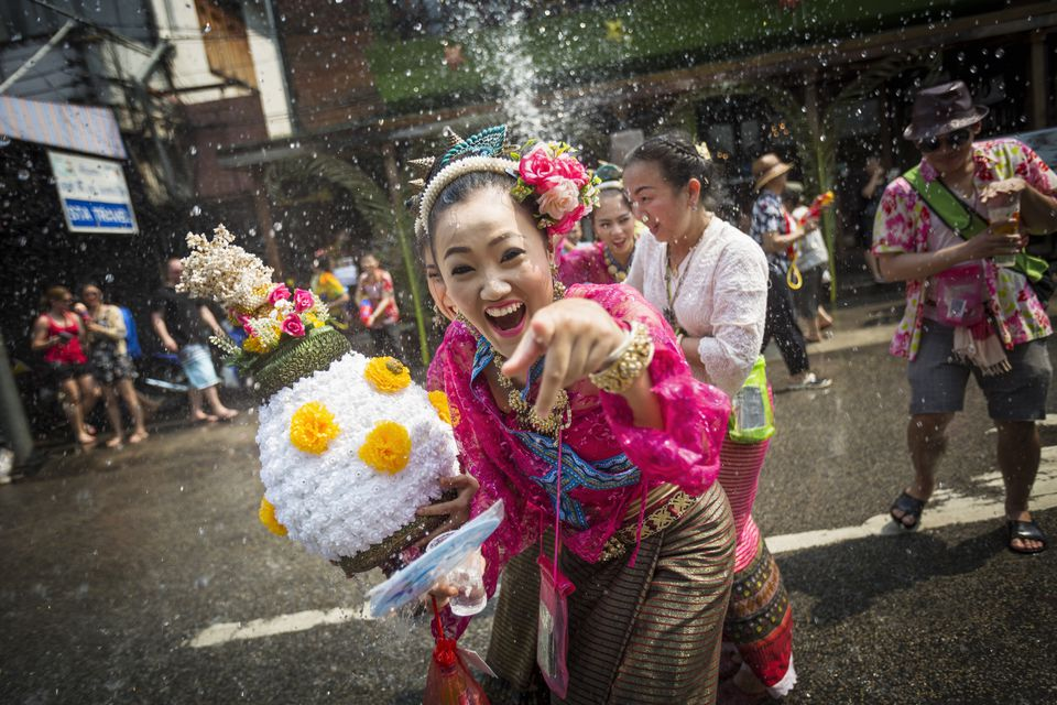 Woman in traditional dress gets soaked at Songkran