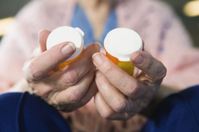 Senior woman comparing medications